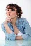 Woman shushing Stock Image