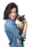 Woman with siamese cat. Woman in her forties holding siamese cat Royalty Free Stock Image