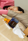 Woman sick in Bed Stock Images