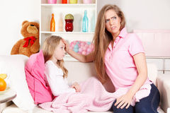 Woman with sick child Stock Photos