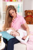 Woman with sick child Stock Images