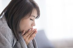 Woman sick and feel cold royalty free stock photography