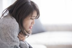 Woman sick and feel cold stock photography