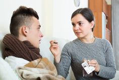 Woman and sick teenage son at home Royalty Free Stock Images