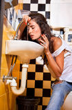 Woman with sickness  into toilet. Royalty Free Stock Images