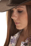 Woman side close in hat look down Stock Photography