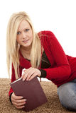 Woman on side holding book Royalty Free Stock Images