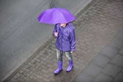 Woman on the sidewalk with umbrella Royalty Free Stock Images