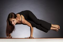 Woman in sideways crow pose (Ashtavakrasana) Stock Photo