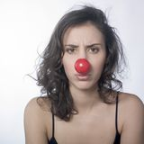 Woman sighing with red nose. A pretty young woman wearing red nose with an unhappy expression on face Stock Images