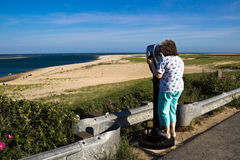 Woman Sight-seeing at a Cape Cod Beach Royalty Free Stock Image