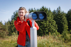 Woman with sightseeing binoculars Royalty Free Stock Photos