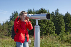 Woman with sightseeing binoculars Royalty Free Stock Image