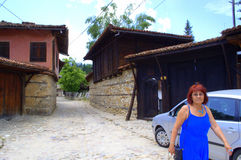 Woman sightseeing in Koprivshtitsa Bulgaria Royalty Free Stock Photo