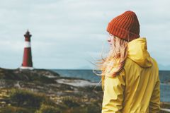 Woman sightseeing lighthouse sea landscape in Norway Travel Lifestyle concept scandinavian vacations outdoor Royalty Free Stock Image