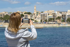 Woman sightseeing and taking photos Royalty Free Stock Images
