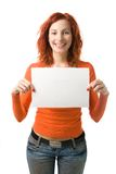 Woman with sign. Red haired woman holding an empty sign Stock Images