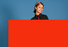 Woman with Sign. A attractive young woman holding a big red sign royalty free stock photography