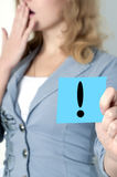 Woman with a sign. Woman with an exclamation mark Royalty Free Stock Photos