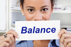 Woman with sign balance in life in her hands Stock Photography