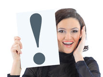 Woman with a sign exclamation mark Royalty Free Stock Image