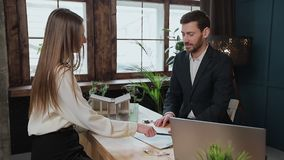 Woman sign mortgage contract, put signature on sale purchase rental agreement, handshaking realtor at meeting with. Estate agent, satisfied customers buy stock video footage
