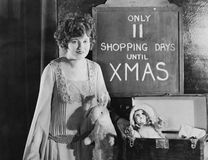 Woman with sign with number of shopping days until Christmas Royalty Free Stock Image