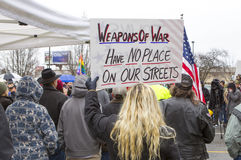 Woman with sign at protest. Spokane, Washington USA - December 20, 2014. A woman holds a protest sign at a rally in Spokane Valley, Washington Stock Photography