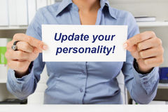 Woman with sign - Update your personality. Hands with poster - Update your personality stock images