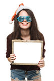 Woman with a sign in white Christmas hat Royalty Free Stock Photo