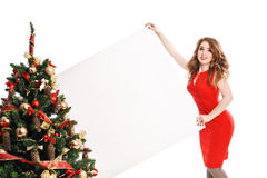 Woman with a sign in white Christmas hat Stock Photo
