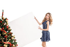 Woman with a sign in white Christmas hat Stock Images