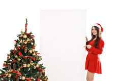 Woman with a sign in white Christmas hat Stock Image