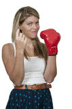 Woman Signaling to Come Here. A beautiful woman wearing a boxing glove signaling with her finger for someone to come here Stock Images