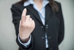 Woman signals come here with one finger Royalty Free Stock Images