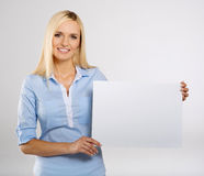 Woman with signboard. Woman portrait with blank white signboard Royalty Free Stock Images