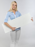 Woman with signboard Stock Images