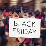 Woman with a signboard with the text black friday Stock Photos