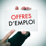 Woman with a signboard with the text offres d'emploi, jobs in fr Royalty Free Stock Photography