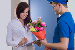 Woman Signing For Bouquet Delivery Stock Photos