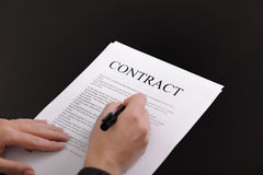 Woman signing contract Stock Images