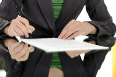 Woman signing contract stock image