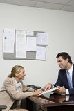 Woman signing contract Stock Photos