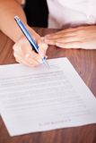 Woman signing the contract paper Royalty Free Stock Photo
