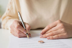 Woman signing divorce papers. Sad Woman signing divorce papers Stock Photos