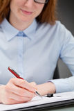 Woman Signing Document or Contract Royalty Free Stock Image