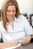 Woman signing documents Stock Photos