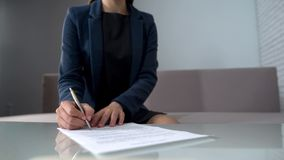 Woman signing documents to receive money, taking loan in bank, startup business. Stock photo stock photo