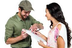 Woman signing for pack delivery with smiling postman Stock Photo