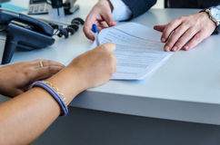 Woman signing Stock Images